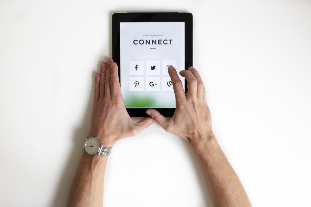 Social media icon apps on a tablet screen