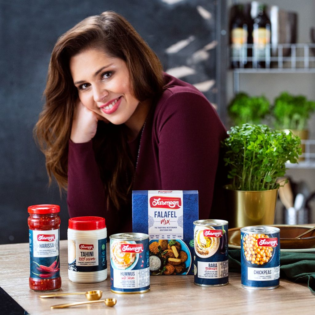Woman with Jasmeen products, grocery products