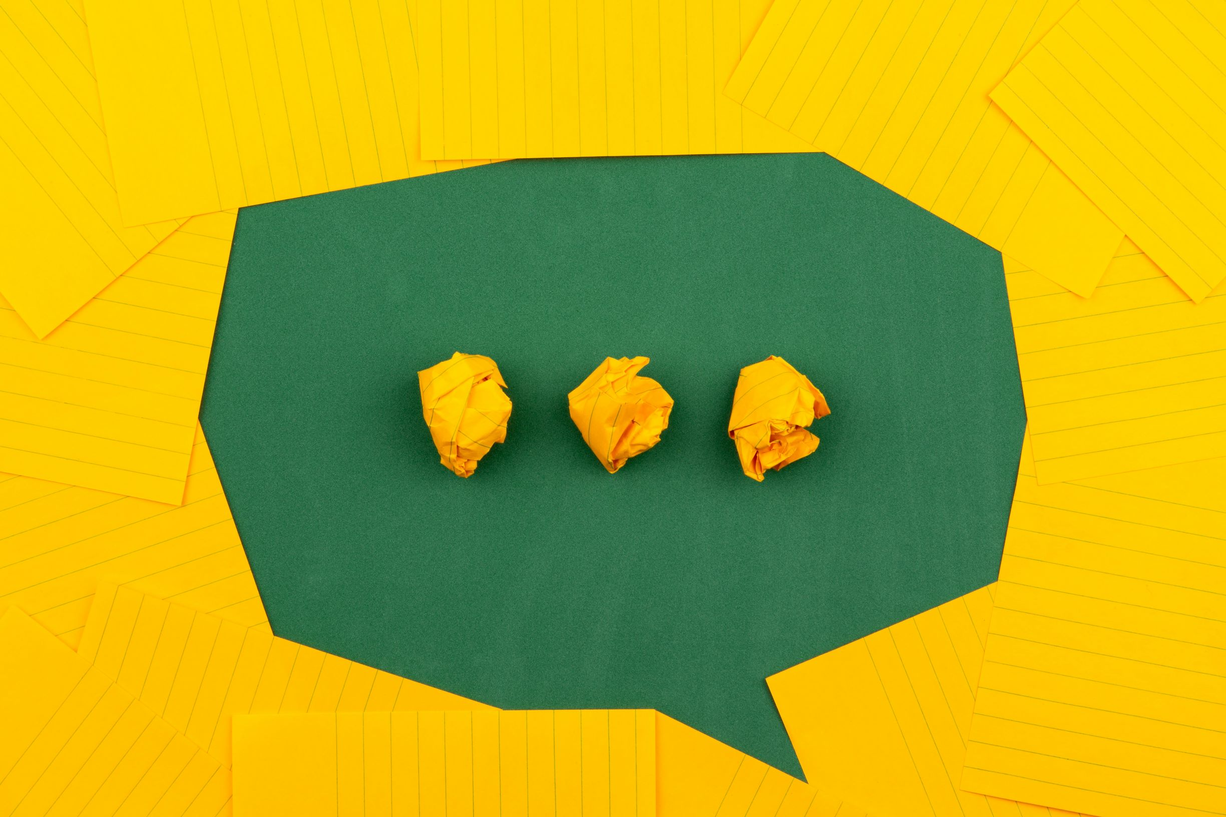 green chat icon on a yellow filed